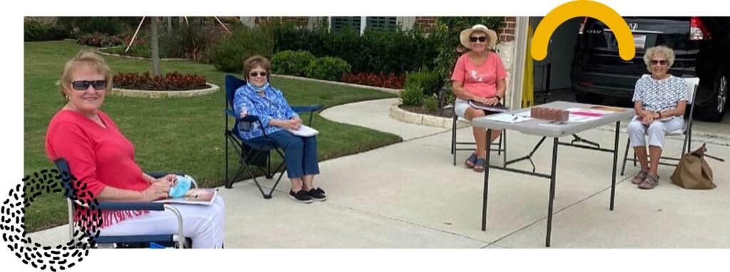photo: senior adults meeting socially distanced